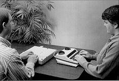 Picture of two people working with the TeleBraille